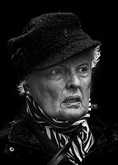 Portrait (D80_539087) (Itzick) Tags: denmark copenhagen candid bw blackbackground bwportrait hat woman maturewoman streetphotography scarf portrait face facialexpression d800 itzick
