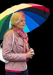 Rainbow on black (D80_538932) (Itzick) Tags: denmark copenhagen candid color colorportrait rainbow woman earrings bag umbrella streetphotography face facialexpression portrait d800 itzick