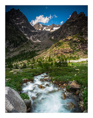A Marked Finale (Augmented Reality Images (Getty Contributor)) Tags: nisifilters alpine alps bluesky canon clouds europe glacier grandcoldeferret ice italy landscape montblancmassif moraine mountains rock snow summer trees valledaosta valley vanguard water waterfall