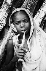 Suri (Rod Waddington) Tags: africa african afrique afrika äthiopien ethiopia ethiopian ethnic ethnicity etiopia ethiopie etiopian omovalley outdoor omo omoriver suri tribe traditional tribal boy blackandwhite knife culture cultural