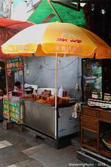 Large orange umbrella - Beiyuanmen Street - Muslim Food street - Xi'An Shaanxi China (WanderingPJB) Tags: flickruploaded umbrella beiyuanmenstreet muslimfoodstreet xian shaanxi peoplesrepublic silkroad china
