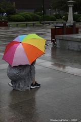 Crouching multicoloured umbrella - Great Wild Goose Pagoda - Xi'An Shaanxi China (WanderingPJB) Tags: flickruploaded umbrella