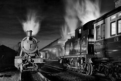 Great Western night scene (Iand49) Tags: transport railway railroad rail train passengertrain carriage steam locomotives engines gwr 280 tankengine britishrailways greatcentralrailway loughborough leicestershire england night dark atmospheric moody monochrome blackandwhite station rails platform awning lamps historic heritage nostalgia evocative power speed motion preservation restored