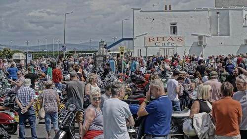 Scooterists in front of Rita's Cafe, Morecambe Scooter Rally 2019