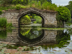 Old Castle Bridge (Ian M Bentley) Tags: wawick warwickcastle oldcastlebridge medievalbridge bridge ruin arch historicengland gradeii listedbuilding walls stonebridge stonewalls olympus omd em1ii zuikolens zuiko12200 12200mm zuiko12200mm olympus12200mm 24400mm wideangle megazoom telephoto zoomlens july m43 microfourthirds handheld stormy clouds stormyweather warwickshire england uk europe reflections reflection enchanting outdoor architecture historic history landscape landmark river riveravon water