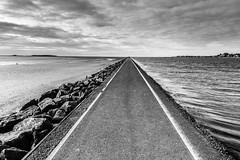 West Kirby (Philip Brookes) Tags: path beach sand coast shore lake marine westkirby wirral merseyside monochrome sky cloud water hilbreisland rock
