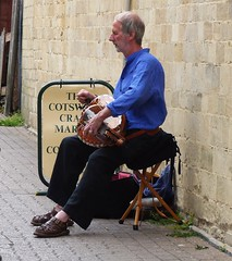 Cirencester ... follow the hurdy-gurdy man (bazzadarambler) Tags: cirencester gloucestershire cotswolds july