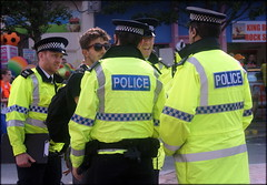 Slowly but surely ... (* RICHARD M (Over 9.5 MILLION VIEWS)) Tags: street candid cops bobbies police policemen policeofficers firstresponders laworder merseysidepolice hiviz uniforms peakcaps peakedcaps sergeant policesergeant southport sefton merseyside shades sunglasses sunspecs