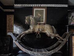 The Toy of Yesterday (Steve Taylor (Photography)) Tags: antique rockinghorse stirrup worn mane rifle zoetrope animal horse picture painting photograph toy seat museum muted pollockstoymuseum