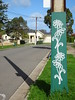 Painted Flowers on a Pole (mikecogh) Tags: stobiepole telegraphpole painted shadow flowers albertpark
