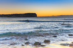 Sunrise Seascape (Merrillie) Tags: daybreak surfing sunrise nature water surfer macmasters centralcoast newsouthwales rocks earlymorning nsw morning sea ocean dawn waterscape landscape coastal macmastersbeach outdoors seascape australia coast sky waves