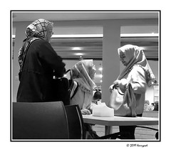 three ladies ... (harrypwt) Tags: harrypwt smartphone indonesia visitindonesia huaweip20pro p20pro borders framed city jakarta light low people shoppingmall mall bw monochrome
