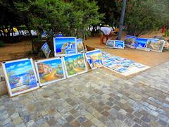 Artist and his Paintings (dimaruss34) Tags: newyork brooklyn dmitriyfomenko image greece athens street cobblestone paintings artist man
