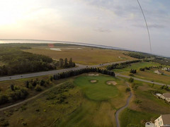 aerial kite photography (Realjh) Tags: kite photography horizon over land sky idyllic beautiful bay michigan pure traverse city really high gopro carbon string air green golf field sand trap grass road intersection line multi kites single low tech
