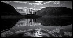 Lake Reflections (VanveenJF) Tags: minnewanka lake banff alberta bw landscape park parkscanada holiday vacation water sony voigtlander heliar wideangle island dark trees canada kanada