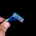 Plastic Razor in the hand above black background