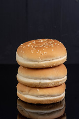 Hamburger Buns isolated above black background (wuestenigel) Tags: american fastfood fast bread meat salad delicious bakery meal baked wheat path eating blackbackground isolated cheeseburger bun closeup fresh clipping food snack big empty healthy cuisine gourmet burger whitebackground nutrition classic sesame hamburger reflective tasty lunch object seed beef sandwich view white 2019 2020 2021 2022 2023 2024 2025 2026 2027 2028 2029 2030