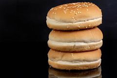 Hamburger Buns above black reflective background with copy space (wuestenigel) Tags: american fastfood fast bread meat salad delicious bakery meal baked wheat path eating blackbackground isolated cheeseburger bun closeup fresh clipping food snack big empty healthy cuisine gourmet burger whitebackground nutrition classic sesame hamburger reflective tasty lunch object seed beef sandwich view white