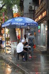 Sitting under the large blue umbrella - Beiyuanmen Street - Muslim Food street - Xi'An Shaanxi China (WanderingPJB) Tags: flickruploaded umbrella silkroad beiyuanmenstreet muslimfoodstreet blue sitting under china peoplesrepublic