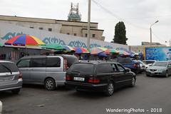 A long Row of umbrellas - Osh Bazaar Bishkek Kyrgyzstan (WanderingPJB) Tags: flickruploaded umbrella kyrgyzstan kyrgyzrepublic kirghizia bishkek oshbazaar market