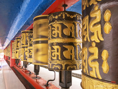 Spinning Prayer wheels at the Do-Drul Chorton Stupa - Gangtok Sikkim India (WanderingPJB) Tags: india sikkim himalayas foothills buddhism dodrulchortonstupa wheels gangtok spinning prayerwheels