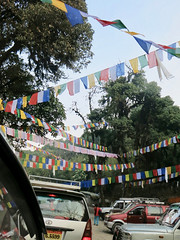 A queue of cars & prayer flags leaving Tiger Hill Observatory - Tiger Hill Darjeeling West Bengal India (WanderingPJB) Tags: accumulation flickruploaded india westbengal darjeeling himalayas foothills queue cars prayerflags tigerhill observatory
