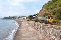 Too soon (Teignstu) Tags: teignmouth devon seawall railway freightliner class66 66562 66618 wall sea ness