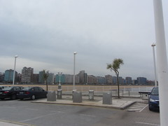 Gijon, view  of  San  Lorenzo  Beach, Asturias, Spain (d.kevan) Tags: gijon asturias spain beach sand coast buildings promenade trees railings rubbishbins views cars streetlamps colours steps