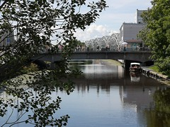 City channel at Central Market in Riga, Latvia. July 14, 2019 (Aris Jansons) Tags: outdoors summer buildings trees channel water bridge boat city capital riga latvia baltic europe 2019