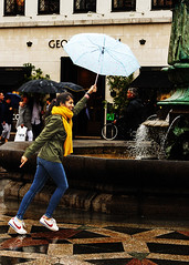 A rainy day (D80_538975) (Itzick) Tags: denmark copenhagen candid color umbrella water streetphotography scarf movement moving statue fountain d800 itzick