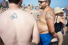 Tattoos (dtanist) Tags: nyc newyork newyorkcity new york city sony a7 7artisans 35mm brooklyn brighton beach tattoos tattoo beachgoers sand sea
