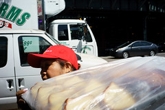 Delivery (dtanist) Tags: nyc newyork newyorkcity new york city sony a7 7artisans 35mm brooklyn coney island beach sand delivery woman hat cap baked food tray