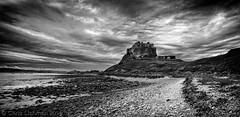 Moody Skies over Lindisfarne Castle (Chris Lishman) Tags: lindisfarne northumberland england uk europe travel blackandwhite landscape holyisland castle lindisfarnecastle nationaltrust fishing fishingvillage skies moody bw