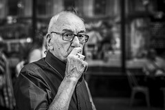 Under the Grip (Leanne Boulton) Tags: street portrait urban candid streetphotography streetportrait streetlife portraiture candidportrait candidstreetphotography old man male face eyes mood emotion expression cigarette smoke smoking elderly feeling smoker glasses detail texture bokeh depthoffield tone light outdoor naturallight shade life city people living humanity culture lifestyle scene human society uk blackandwhite bw white black monochrome canon 50mm mono scotland blackwhite glasgow ef50mmf14usm primelens canon5dmkiii