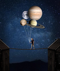 Balance the universe (Ekaterina Toseva) Tags: photoshop edited composite experimental creative manipulation photomanipulation universe balance emotional autoportrait selfportrait expression silhouette planets space balancing night dark buildings colorcast above balloons present gift dreams