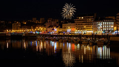 Inner harbor under 13th of July fireworks (Foufourquemin) Tags: cherbourg normandy cotentin fireworks reflection water harbor boat lights night town buildings