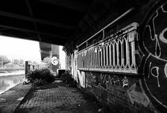 (a.pierre4840) Tags: olympus om3 zuiko 24mm f28 35mmfilm ilford ilfordhp5 hp5 hp5plus bw blackandwhite noiretblanc urban decay graffiti bridge river london england