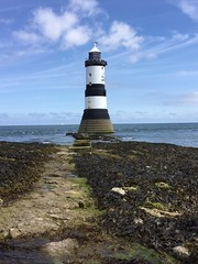 All is calm at sea (Wilf41/Maggie) Tags: lighthouse sea ocean sky blue foreground clouds anglesey isle isleofanglesey