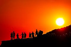 We all live under the same sun - Wir leben alle unter der selben Sonne (TS Lichtreise) Tags: licht light sonne sun red gelb schwarz rot yellow black people felsen rock outside sunset himmel sky orange sigma fringer fuji silhouette shine schein