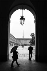 Quando piove - When it rains. (sinetempore) Tags: quandopiove whenitrains pioggia rain umbrella ombrello street torino turin moleantonelliana piazzacastello portici arcade silhouette biancoenero blackandwhite