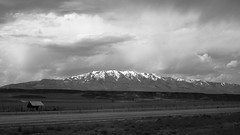 Mountain Road, Cloudy Day (Nick Condon) Tags: blackandwhite clouds idaho landscape mountain olympus25mm olympusem10 road