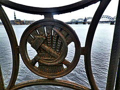 Soviet legacy on river Daugava embankment. Riga, Latvia. (Aris Jansons) Tags: ironwork railing sickle hammer soviet river daugava latvia riga baltic europe europeanunion city capital bridge spires towers water