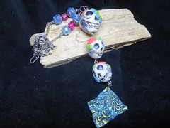 Polymer Clay A Trio of Skulls by LynzCraftz Designz (2) (LynzCraftz) Tags: polymerclay pendant resin acrylicpaint art alcoholink embossing powder glassstone glitter goddess jewelry necklace oneofakind handmade