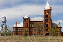 Westminster Castle / Pillar of Fire (BeerAndLoathing) Tags: castle usa denver rp church sandstone buildings canon red canonrf24105mmf4lisusm spring colorado canoneosrp westminster architecture may 2019 watertower