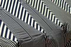 On the beach (Manuel Chagas) Tags: beach strip black white blue tent sun praia areia holiday holidays tents tenda tendas roof four mft microfourthirds manuelchagas carlzeiss 135mm f35 manualfocus vintage lens fabric cotton carlzeiss135mmf35 carlzeissjenna135mmf35
