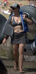 Walking With Raft (Scott 97006) Tags: woman female lady walk inflatable skirt bikini cap cute