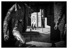 Guarding the Guardians (Dave Button) Tags: warsaw poland bw blackwhite mono monochrome fuji fujifilm acros xe2s xe2 city street urban statue border 27mm