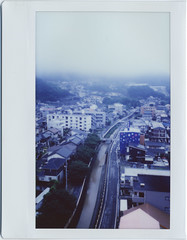 town waking up in rain and fog (breeze.kaze) Tags: film rain clouds town earlymorning hills instant 520am fujiinstaxwidefilm mintinstantkonrf70 dawn fogtowardseast f16 a1