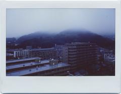rained all night (breeze.kaze) Tags: film rain fog clouds town earlymorning hills instant 540am fujiinstaxwidefilm towardsnorth mintinstantkonrf70 dawn f22 a1