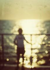 A thousand suns (Mister Blur) Tags: blur thousand suns blurry dots caribbean sea mar caribe cozumel catamarán boy dusk atardecer golden hour sparkling light rivieramaya snapseed nikon d7100 35mm nikkor lens chicane rubén rodrigo fotografía